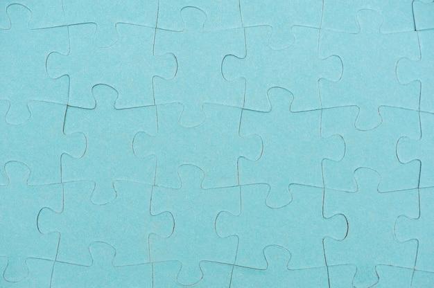 Fond de pièces de puzzle bleu vue de dessus