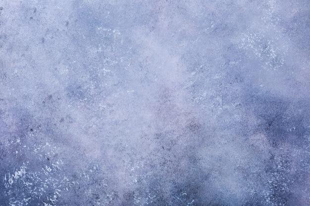 Fond de pierre de béton bleu violet