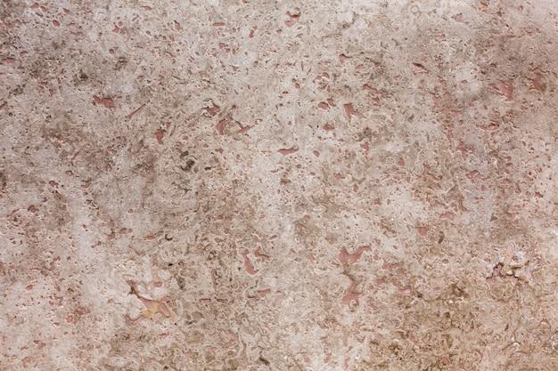 Fond de pierre brute pâle