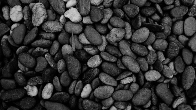 Fond de pierre noire. galet noir plage pierre