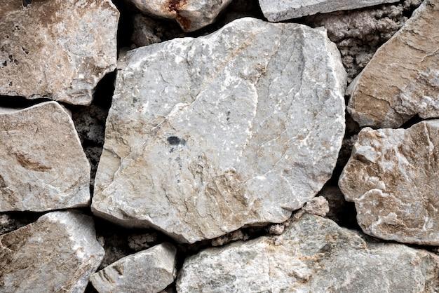 Fond de pierre ronde et pentagone