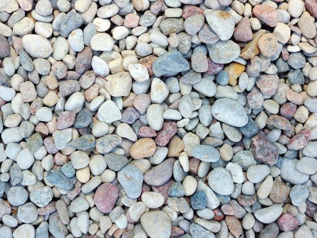Fond de pierres de mer naturelles grises
