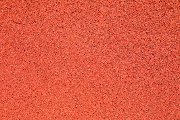 Fond de piste de course en caoutchouc rouge, vue de dessus