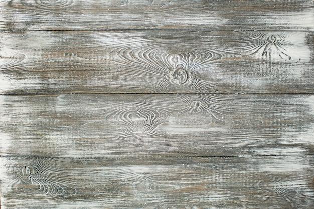 Fond de planche blanchâtre en bois ancien gris. rayures horizontales