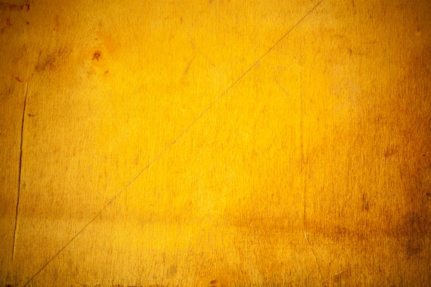 Fond de planche de bois jaune.