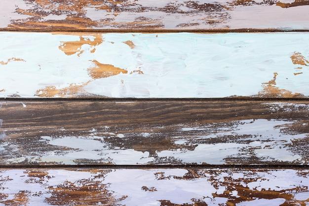 Fond de planche de bois multicolore ancien. rayures horizontales