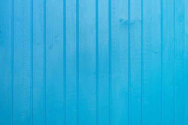 Fond de planche de bois peint en bleu se bouchent
