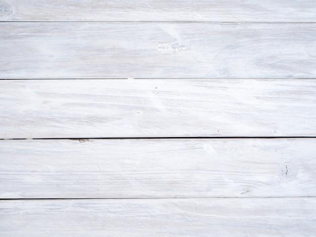 Fond de planche de bois texturé blanc