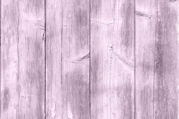Un fond de planche de bois usé violet pastel, texture