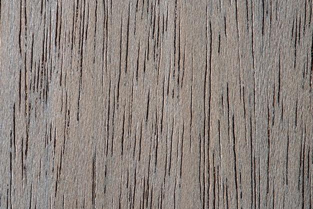 Fond de plancher texturé en bois brun fané