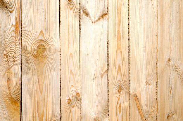 Fond de planches de bois brunes nues non peintes