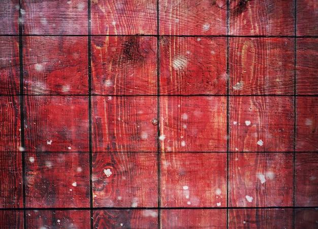 Fond de planches de bois avec effet bokeh neige et paillettes.