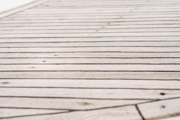 Fond de planches de bois gris usés.