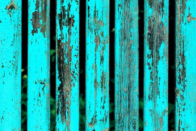 Fond avec des planches en bois minables de couleur bleue.