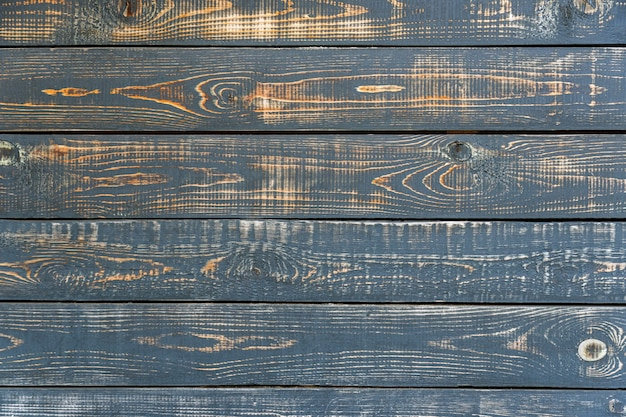 Fond de planches de bois sombre, noir, planche de bois minable avec peinture craquelée