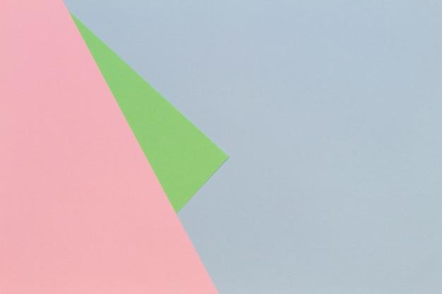 Fond plat géométrique de papier de couleur pastel bleu rose vert