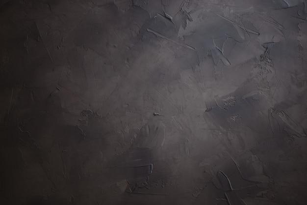 Fond de plâtre foncé, fond photo texturé fabriqué à la main
