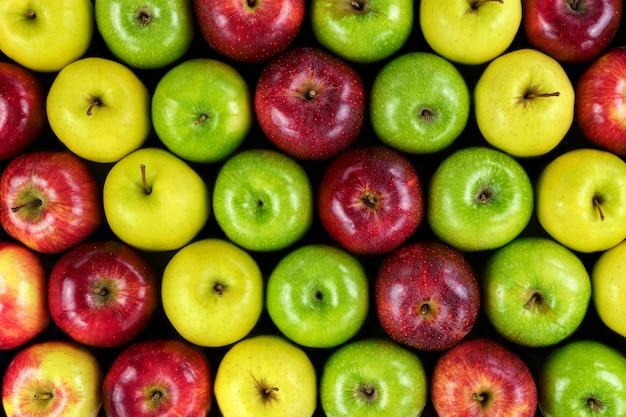 Fond de pommes de différentes couleurs.