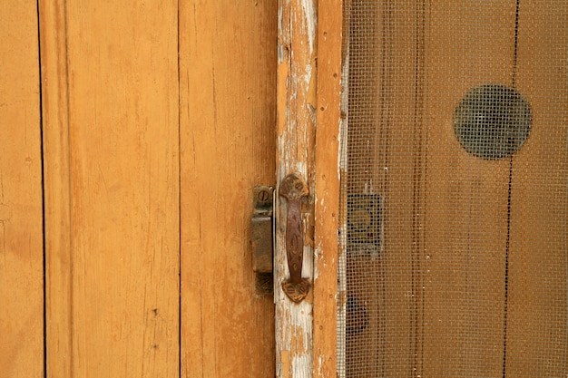 Fond de porte en bois âgé de grunge