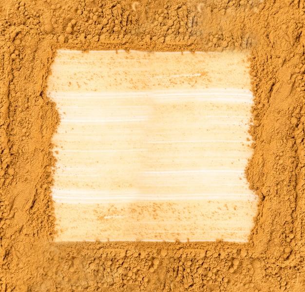 Fond de poudre de cannelle sèche
