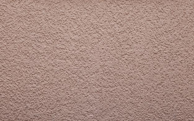 Fond rose clair ou texture - mur en plâtre avec ornement