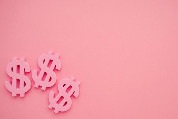 Fond rose avec symboles dollar, signe d'argent