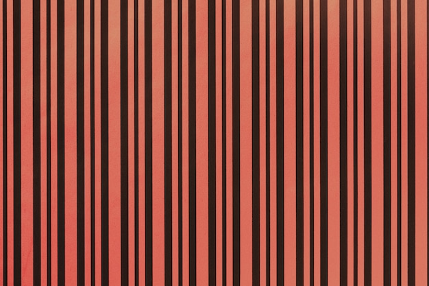 Fond rouge et noir foncé de papier rayé d'emballage