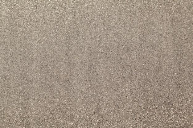 Fond de sable humide texturé