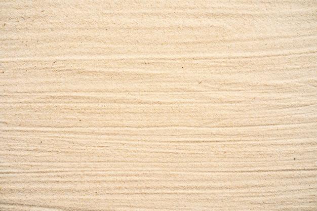 Fond de sable texturé sur la plage.