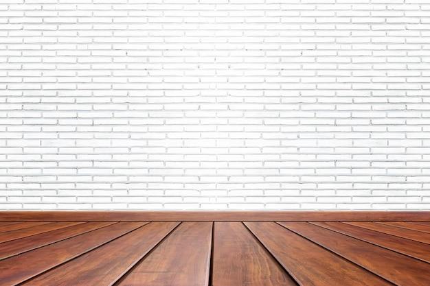 Fond de la salle intérieure vide avec mur de ciment blanc et plancher en bois marron