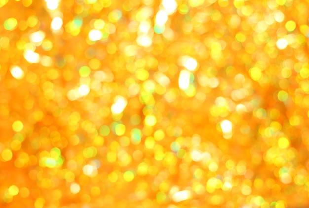 Fond scintillant de noël. bokeh doré - texture abstraite