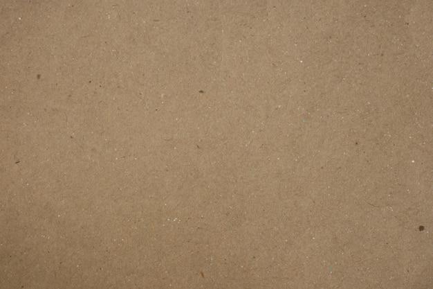 Fond sombre de papier brun pour la conception