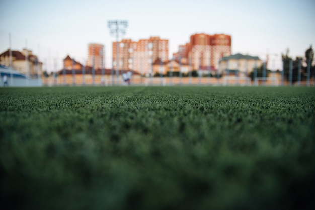 Fond de stade blurred, fond de jeu, flou d'herbe verte, proche paysage