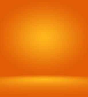 Fond de studio photographique orange vertical avec vignette douce. fond dégradé doux. toile de fond de studio de toile peinte.