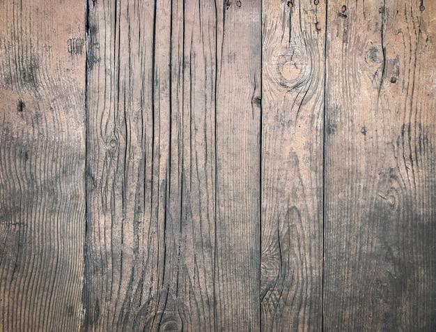 Fond d'une surface en bois patiné avec un espace de copie
