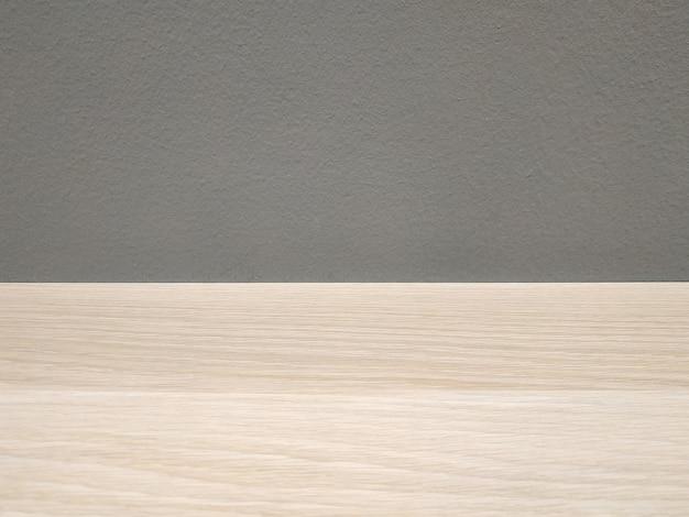 Fond avec une table en bois sur fond de mur gris