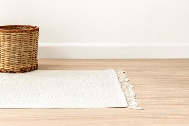 Fond de tapis tissé blanc sur le sol