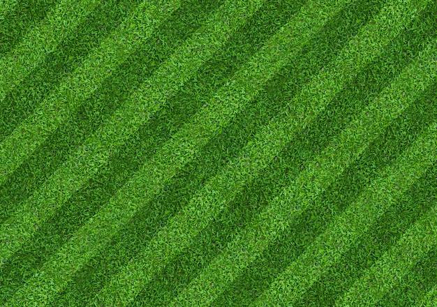 Fond de terrain d'herbe verte pour les sports de football et de football. fond de texture de pelouse verte. fermer.