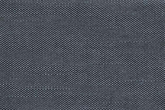 Fond textile bleu foncé avec damier, gros plan. structure de la macro de structure.