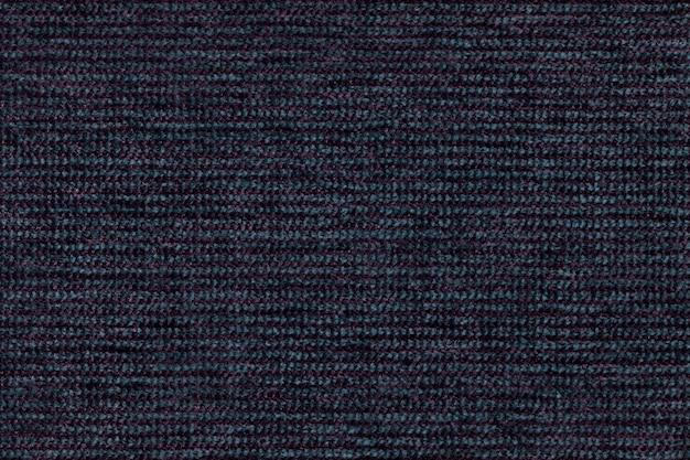 Fond textile bleu foncé avec design damier, gros plan.