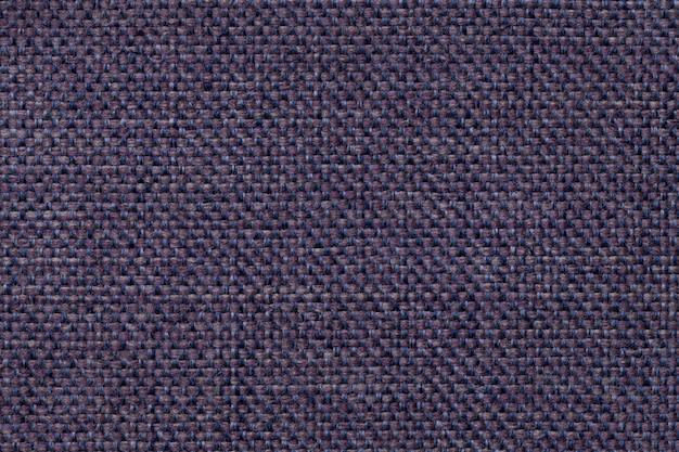 Fond textile bleu foncé avec motif à carreaux, gros plan. structure de la macro de tissu.