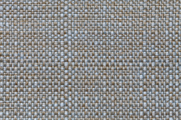 Fond textile bleu et marron avec design damier, gros plan. structure de la macro de structure.