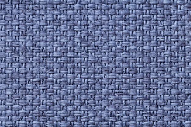 Fond textile bleu avec motif à carreaux, gros plan. structure de la macro de tissu.
