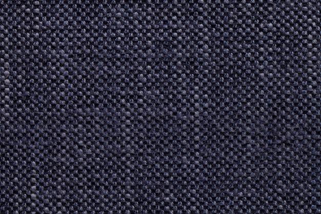 Fond textile denim avec motif à carreaux, gros plan. structure de la macro de tissu.