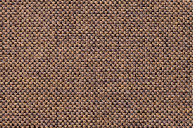 Fond textile marron clair avec motif à carreaux, gros plan. structure de la macro de tissu.