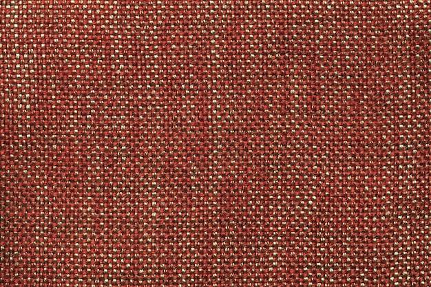 Fond textile orange foncé avec motif à carreaux, gros plan. structure de la macro de tissu.