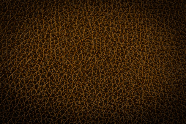 Fond de texture abstraite en cuir doré. ton sombre