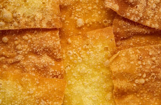 Fond de texture abstraite nourriture wontons croustillants