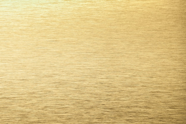 Fond de texture en aluminium doré clair. toile de fond en métal de texture en acier jaune.