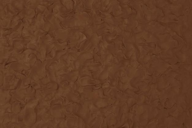 Fond texturé d'argile brune dans un style minimaliste d'art créatif bricolage